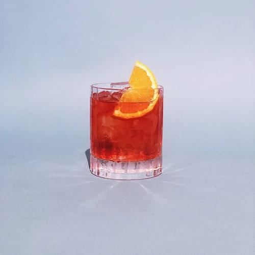 Negroni cocktail with orange slice.