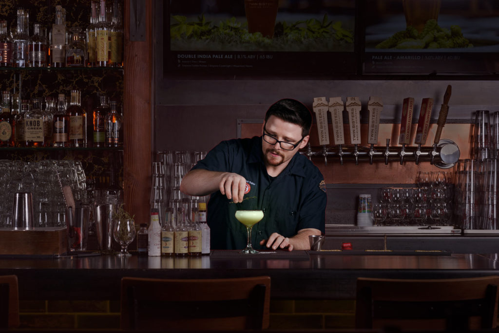Bartender mixing drink.
